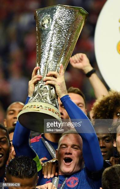 Wayne Rooney of Manchester United lifts The Europa League trophy following victory in the UEFA Europa League Final between Ajax and Manchester United...