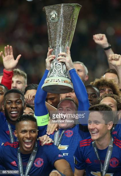 Wayne Rooney of Manchester United lifts the Euroup League trophy after the UEFA Europa League Final match between Manchester United and Ajax at...