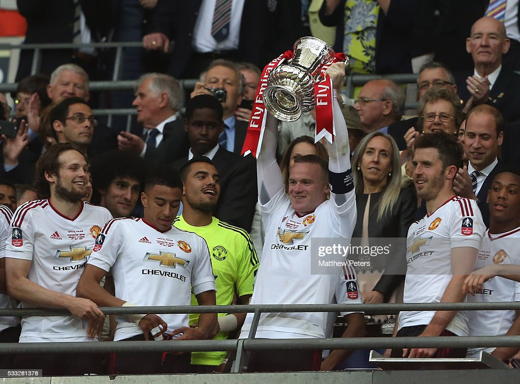 Wayne Rooney of Manchester United lifts the FA Cup after The Emirates FA Cup final match between Manchester United and Crystal Palace at Wembley Stadium on May 21, 2016 in London, England.