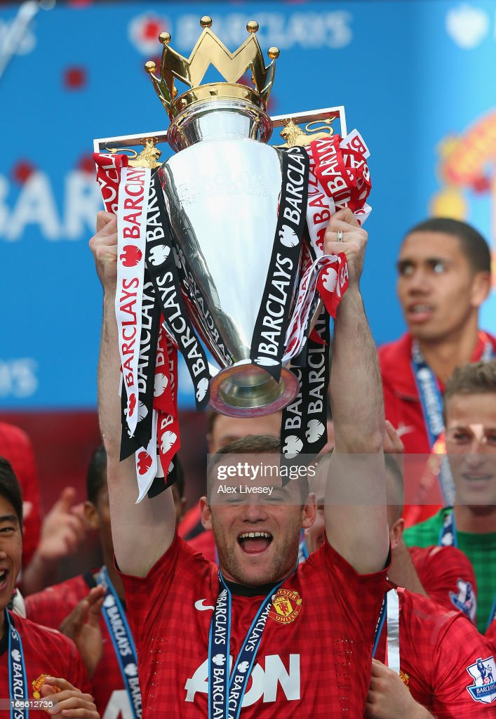 Wayne Rooney of Manchester United lifts the Premier League trophy following the Barclays Premier League match between Manchester United and Swansea City at Old Trafford on May 12, 2013 in Manchester, England.