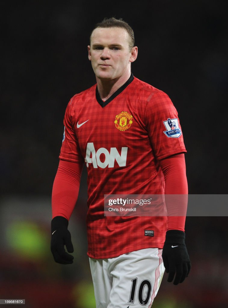 Wayne Rooney of Manchester United look on during the FA Cup with Budweiser Third Round Replay match between Manchester United and West Ham United at Old Trafford on January 16, 2013 in Manchester, England.