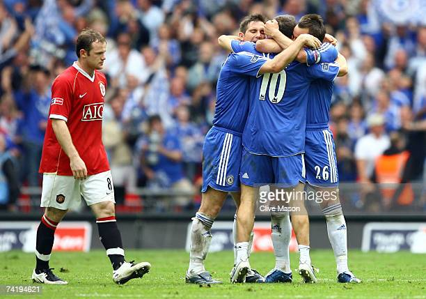Wayne Rooney of Manchester United looks dejected as Frank Lampard, Joe Cole and John Terry of Chelsea celebrate during the FA Cup Final match...