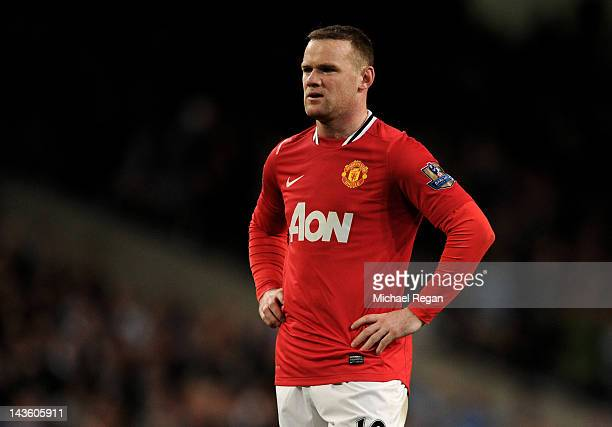 Wayne Rooney of Manchester United looks dejected at the end of the Barclays Premier League match between Manchester City and Manchester United at the...