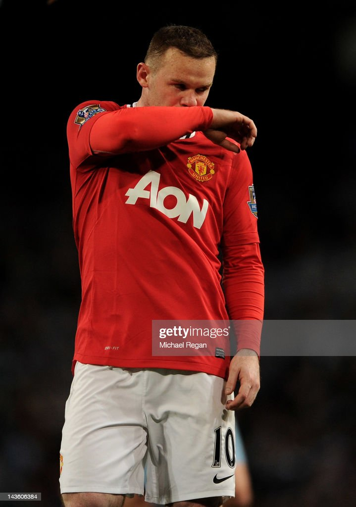 Wayne Rooney of Manchester United looks dejected at the end of the Barclays Premier League match between Manchester City and Manchester United at the Etihad Stadium on April 30, 2012 in Manchester, England.