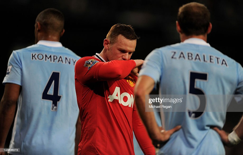 Wayne Rooney of Manchester United looks dejected during the Barclays Premier League match between Manchester City and Manchester United at the Etihad Stadium on April 30, 2012 in Manchester, England.