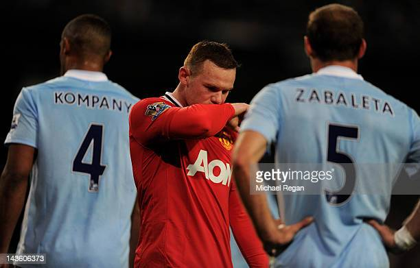 Wayne Rooney of Manchester United looks dejected during the Barclays Premier League match between Manchester City and Manchester United at the Etihad...