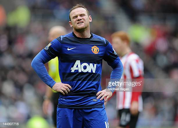 Wayne Rooney of Manchester United looks dejected during the Barclays Premier League match between Sunderland and Manchester United at the Stadium of...