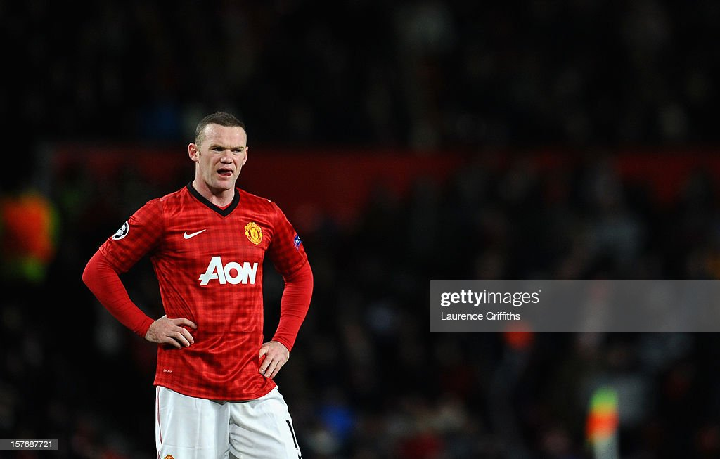Wayne Rooney of Manchester United looks dejected during the UEFA Champions League Group H match between Manchester United and CFR 1907 Cluj at Old Trafford on December 5, 2012 in Manchester, England.