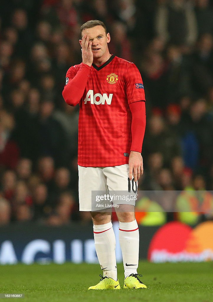 Wayne Rooney of Manchester United looks dejected during the UEFA Champions League Round of 16 Second leg match between Manchester United and Real Madrid at Old Trafford on March 5, 2013 in Manchester, United Kingdom.