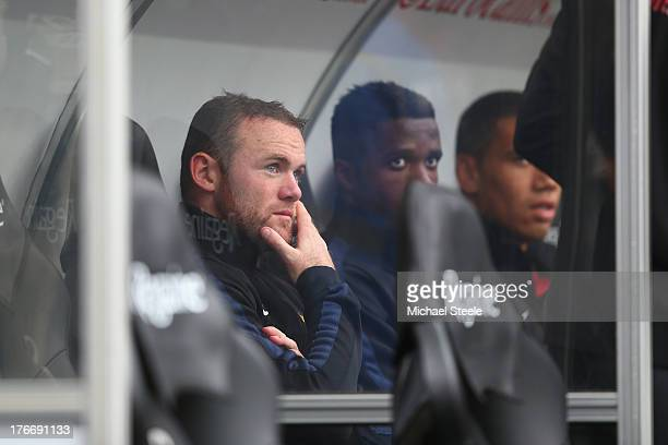 Wayne Rooney of Manchester United looks on from the bench during the Barclays Premier League match between Swansea City and Manchester United at the...