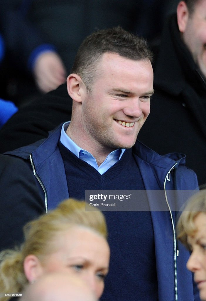 Wayne Rooney of Manchester United looks on from the stand during the FA Cup Fifth Round match between Everton and Blackpool at Goodison Park on February 18, 2012 in Liverpool, England.