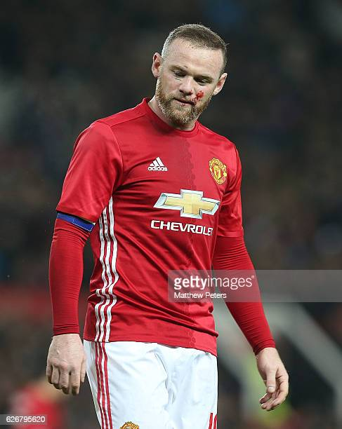 Wayne Rooney of Manchester United picks up a facial injury during the EFL Cup QuarterFinal match between Manchester United and West Ham United at Old...