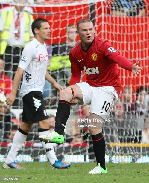 Wayne Rooney of Manchester United picks up a leg injury during the Barclays Premier League match between Manchester United and Fulham at Old Trafford...