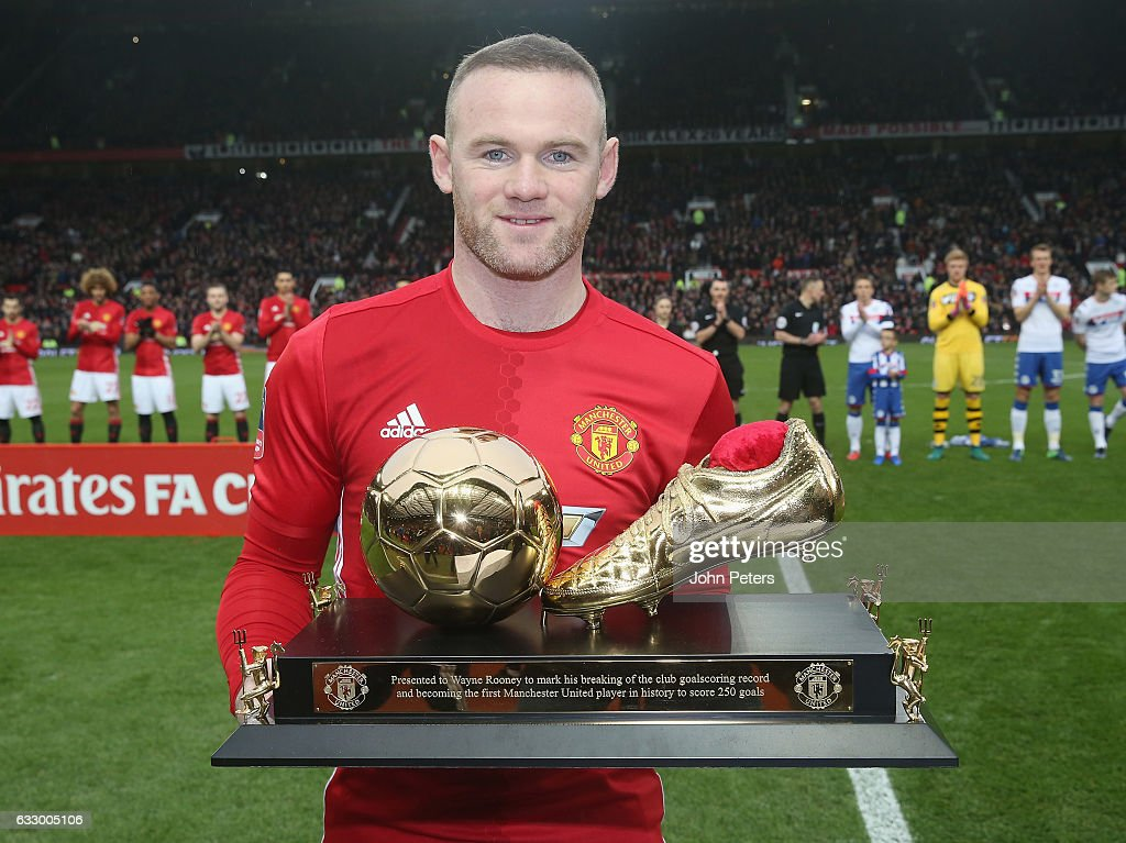 Wayne Rooney of Manchester United poses with a golden boot to mark his 250th Manchester United goal, which saw him break Charlton's club record, ahead of the Emirates FA Cup Fourth Round match between Manchester United and Wigan Athletic at Old Trafford on January 29, 2017 in Manchester, England.