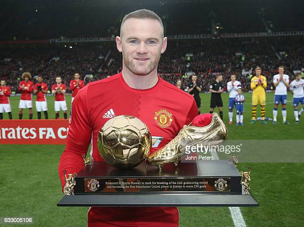 Wayne Rooney of Manchester United poses with a golden boot to mark his 250th Manchester United goal which saw him break Charlton's club record ahead...