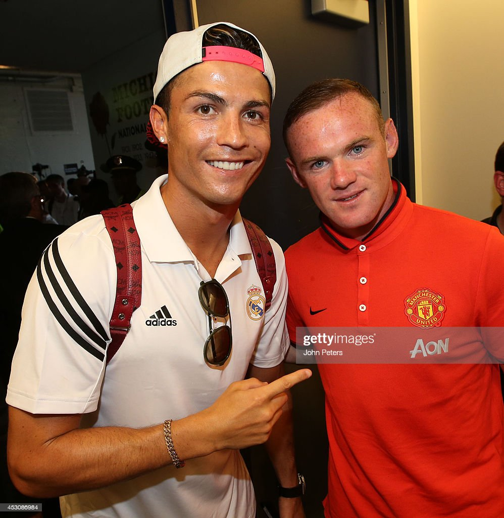 Wayne Rooney of Manchester United poses with Cristiano Ronaldo of Real Madrid after their pre-season friendly match against Real Madrid at Michigan Stadium on August 2, 2014 in Ann Arbor, Michigan.
