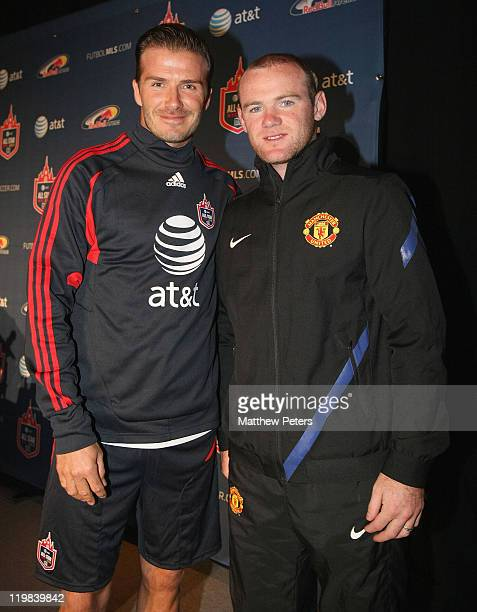 Wayne Rooney of Manchester United poses with David Beckham of the MLS AllStars ahead of the preseason friendly match between Manchester United and...