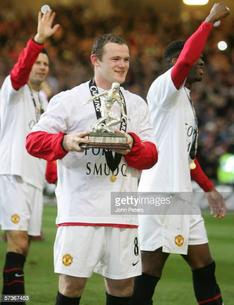 Wayne Rooney of Manchester United poses with his Man of the Match award after the Carling Cup Final match between Manchester United and Wigan...