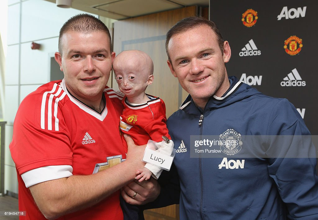 Manchester united foundation dream day photos and images getty images wayne rooney of manchester united poses with lucy 6 from county down at the m4hsunfo Gallery