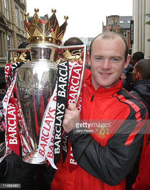 Wayne Rooney of Manchester United poses with the Barclays Premier League trophy during the Manchester United Premier League Winners Parade on May 30...