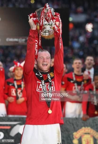 Wayne Rooney of Manchester United poses with the Carling Cup trophy after the Carling Cup Final match between Aston Villa and Manchester United at...