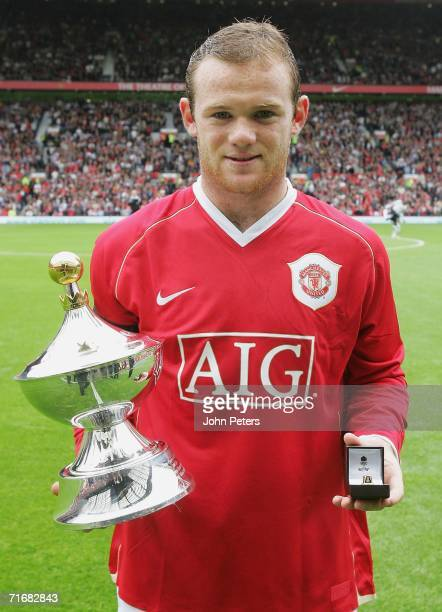 Wayne Rooney of Manchester United poses with the PFA Fans' Player of the Year award ahead of the Barclays Premiership match between Manchester United...