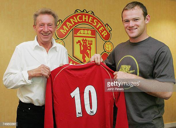 Wayne Rooney of Manchester United poses with United legend Denis Law after it was announced that Rooney would wear the number 10 shirt for the...