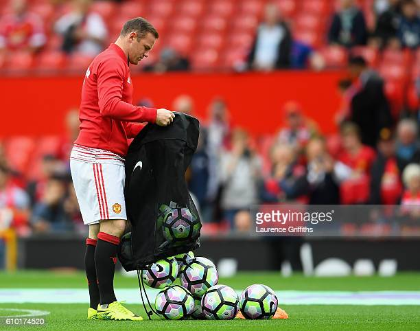 Wayne Rooney of Manchester United prepares for warm up as he is dropped to the becnch for the Premier League match between Manchester United and...