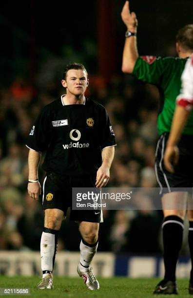 Wayne Rooney of Manchester United questions a call by referee Graham Poll during the Barclays Premiership match between Arsenal and Manchester United...