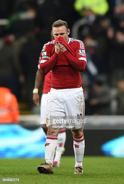 Wayne Rooney of Manchester United reacts after his team draw in the Barclays Premier League match between Newcastle United and Manchester United at...