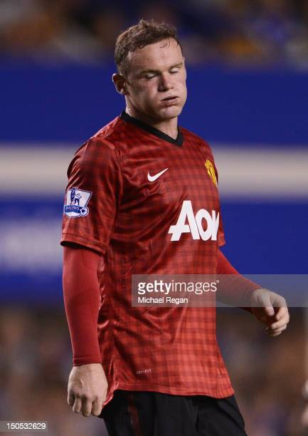 Wayne Rooney of Manchester United reacts during the Barclays Premier League match between Everton and Manchester United at Goodison Park on August 20...