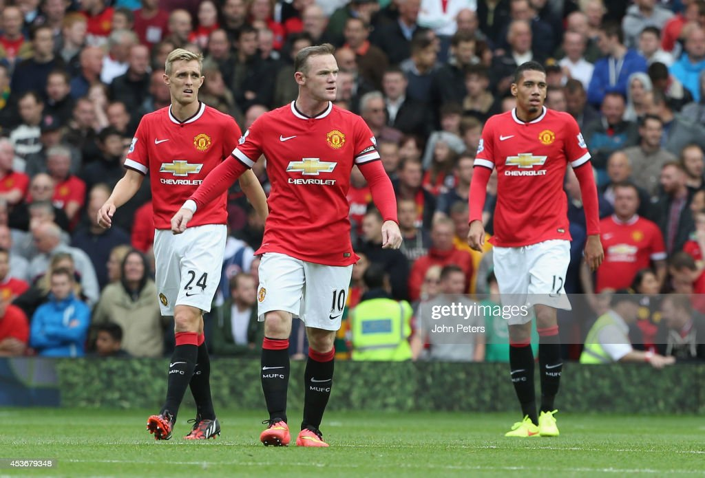 Wayne Rooney of Manchester United reacts to conceding a goal to Swansea City during the Premier League match between Manchester United and Swansea City at Old Trafford on August 16, 2014 in Manchester, England.