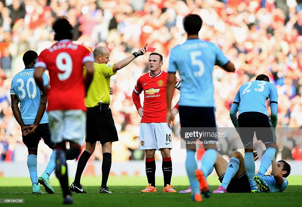 Wayne Rooney of Manchester United receives a straight red card by referee Lee Mason after a foul on Stewart Downing of West Ham during the Barclays Premier League match between Manchester United and West Ham United at Old Trafford on September 27, 2014 in Manchester, England.