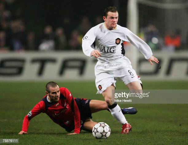 Wayne Rooney of Manchester United rides a challenge from Nicolas Plestan of Lille during the Champions League Round of 16 first leg between Lille and...