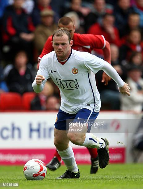 Wayne Rooney of Manchester United runs with the ball during the preseason friendly match between Aberdeen and Manchester United at Pittodrie Stadium...