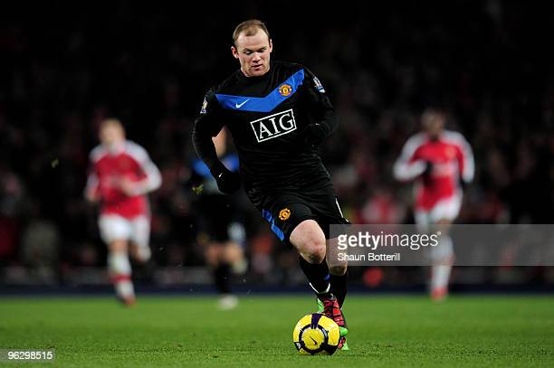 Wayne Rooney of Manchester United runs with the ball during the Barclays Premier League match between Arsenal and Manchester United at The Emirates...