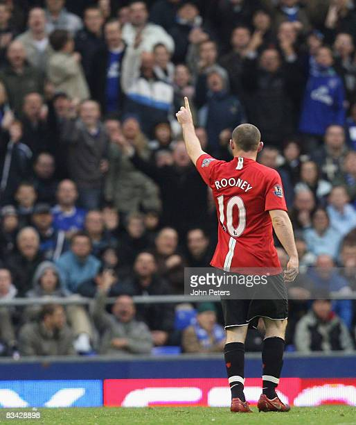 Wayne Rooney of Manchester United salutes the away fans during the Barclays Premier League match between Everton and Manchester United at Goodison...