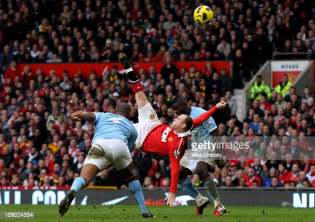 Wayne Rooney of Manchester United scores a goal from an overhead kick during the Barclays Premier League match between Manchester United and...