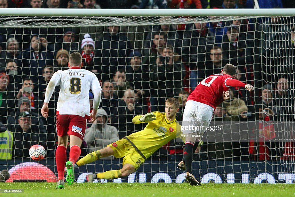 Wayne Rooney of Manchester United scores a late penalty during the Emirates FA Cup Third Round match between Manchester United and Sheffield United at Old Trafford on January 9, 2016 in Manchester, England.