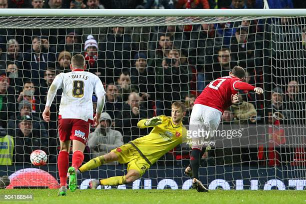 Wayne Rooney of Manchester United scores a late penalty during the Emirates FA Cup Third Round match between Manchester United and Sheffield United...