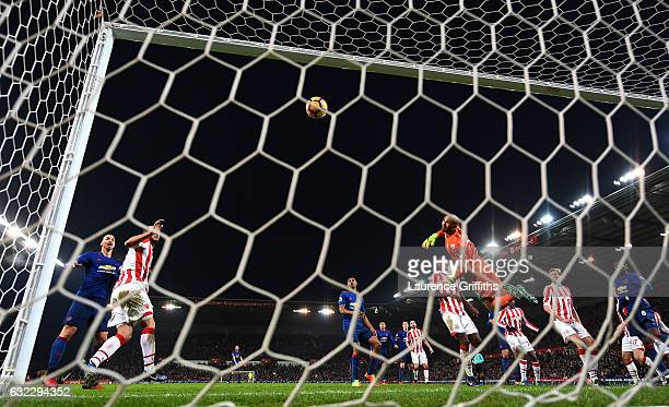 Wayne Rooney of Manchester United scores his sides first goal during the Premier League match between Stoke City and Manchester United at Bet365...