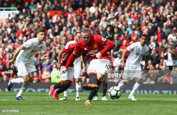Wayne Rooney of Manchester United scores his sides first goal during the Premier League match between Manchester United and Swansea City at Old...