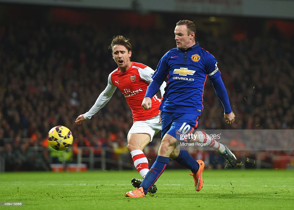 Wayne Rooney of Manchester United scores his team's second goal during the Barclays Premier League match between Arsenal and Manchester United at Emirates Stadium on November 22, 2014 in London, England.
