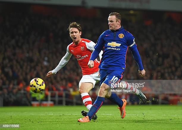 Wayne Rooney of Manchester United scores his team's second goal during the Barclays Premier League match between Arsenal and Manchester United at...