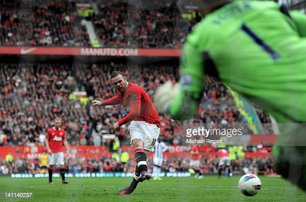 Wayne Rooney of Manchester United scores his team's second goal from a penalty kick during the Barclays Premier League match between Manchester...