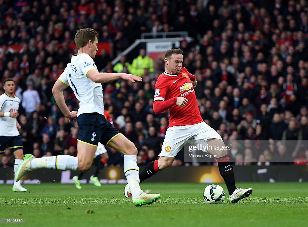 Wayne Rooney of Manchester United scores his team's third goal as Jan Vertonghen of Spurs closes in during the Barclays Premier League match between Manchester United and Tottenham Hotspur at Old Trafford on March 15, 2015 in Manchester, England.