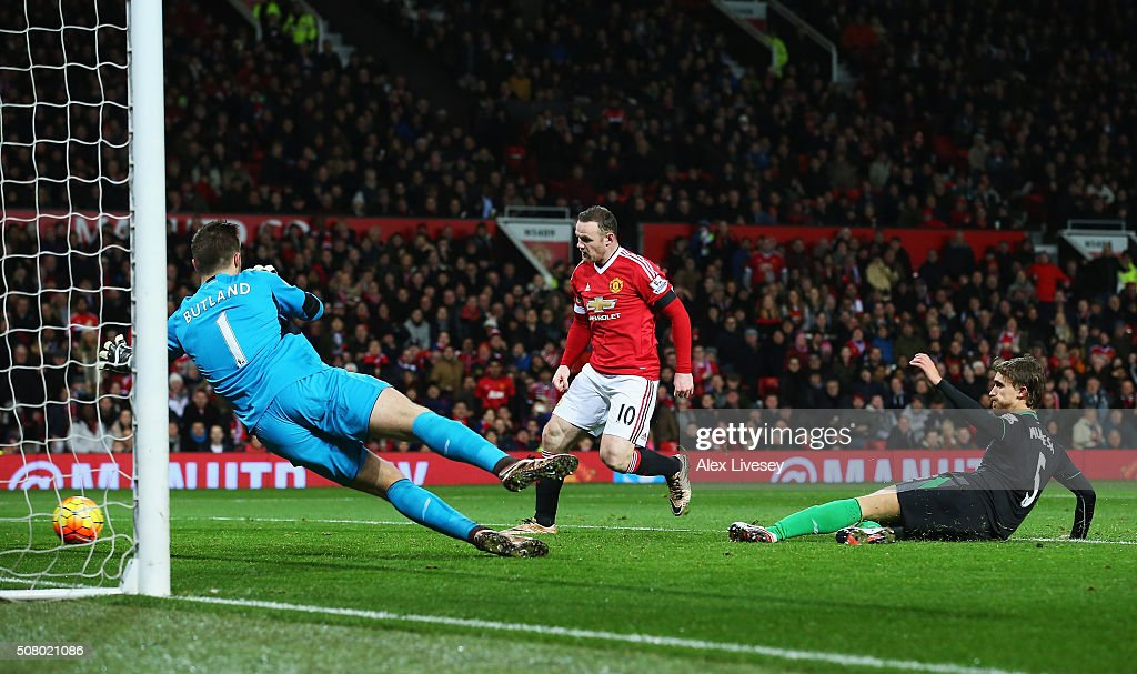 Wayne Rooney of Manchester United scores his team's third goal past Jack Butland of Stoke City during the Barclays Premier League match between Manchester United and Stoke City at Old Trafford on February 2, 2016 in Manchester, England.