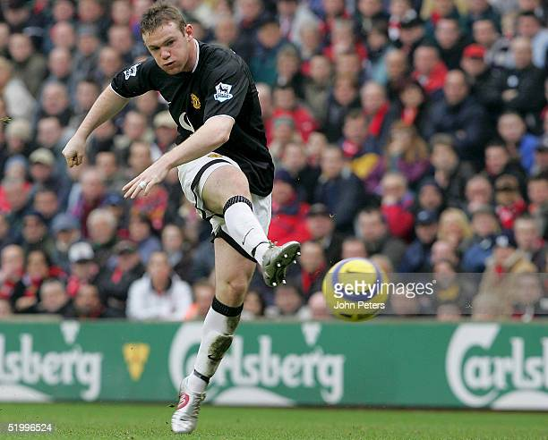 Wayne Rooney of Manchester United scores the first goal during the Barclays Premiership match between Liverpool and Manchester United at Anfield on...