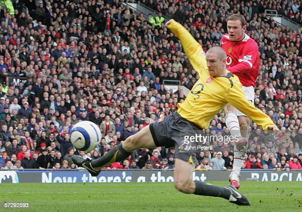 Wayne Rooney of Manchester United scores the first goal during the Barclays Premiership match between Manchester United and Arsenal at Old Trafford...