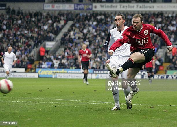 Wayne Rooney of Manchester United scores the first goal during the Barclays Premiership match between Bolton Wanderers and Manchester United at the...